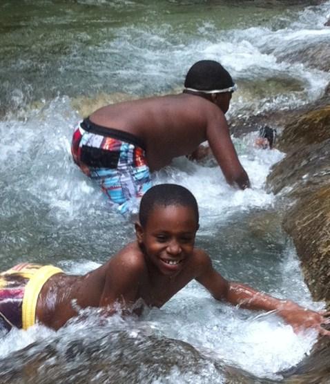 Boys playing Dunn's River Falls