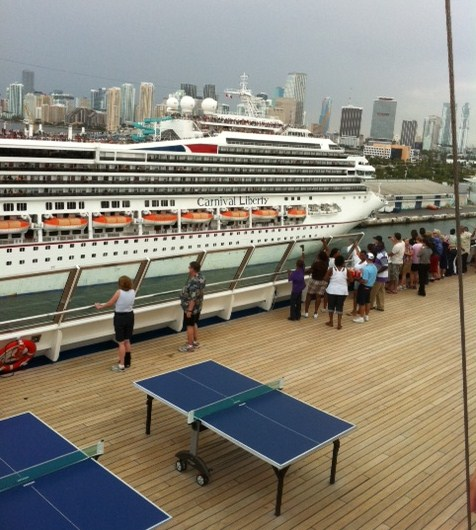 Carnival Destiny leaves Carnival Liberty in Miami Port