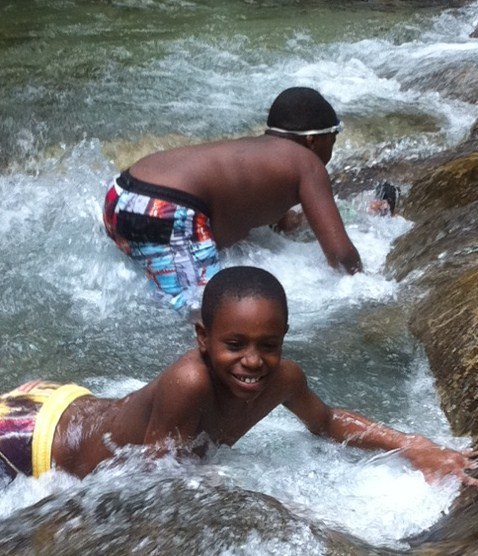 Boys playing Dunn's River Falls